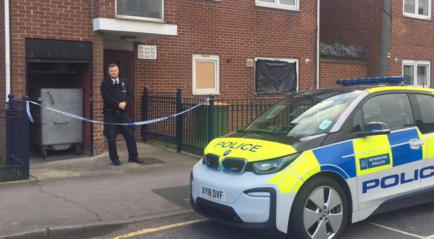 Police at a property on Vandome Close in east London where two women have been found dead (PA)