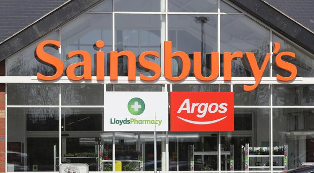 Supermarket Sainsbury's, which has 14 stores in Northern Ireland, has notched up a rise in annual underlying profits but saw hefty charges, including a £46m hit from its failed bid to merge with Asda, knock its bottom line. (Owen Humphreys/PA)
