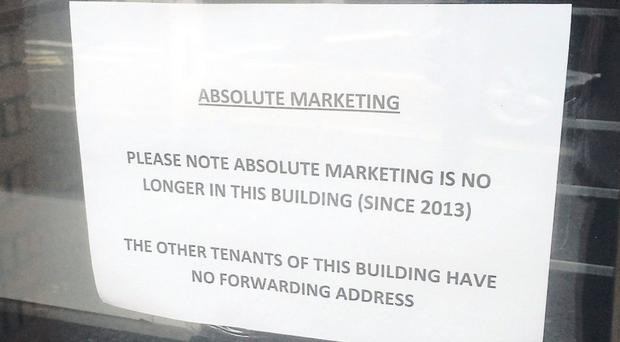 A sign in the window of Absolute Marketing in 2014
