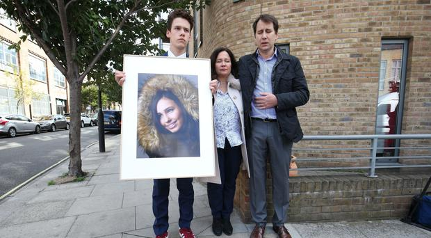 Nadim and Tanya Ednan-Laperouse, with their son Alex, holding a picture of Natasha (PA)