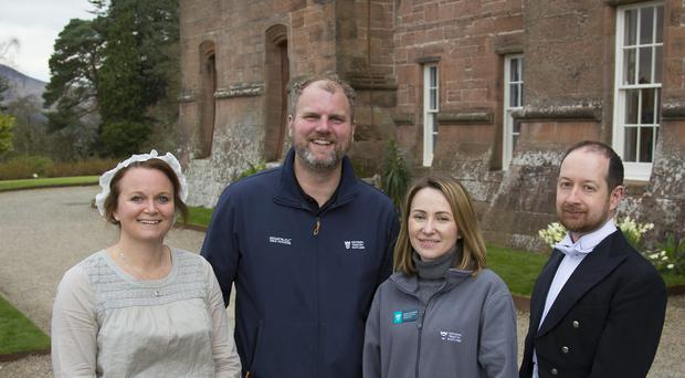 National Trust for Scotland staff (left to right) Catriona Peattie (education guide), Jared Bowers (Operations Manager), Natalia McAllister (education guide), Stuart Montgomery (education guide) outside the revamped Brodick Castle (NTS/PA)