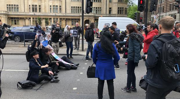 Protesters outside Westminster Magistrates' Court (Aine Fox/PA)