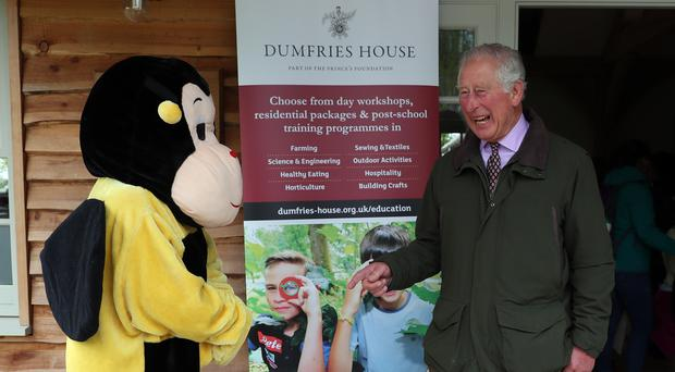 Prince Charles talks to a bumblebee mascot during a visit to the Spring Festival of Farming at Dumfries House in Ayrshire (Andrew Milligan/PA)