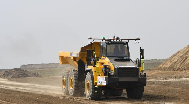 An automated driverless dumper truck during testing for the first time in England on the UK's biggest road upgrade, the scheme to improve the A14 between Cambridge and Huntingdon (Joe Giddens/PA)