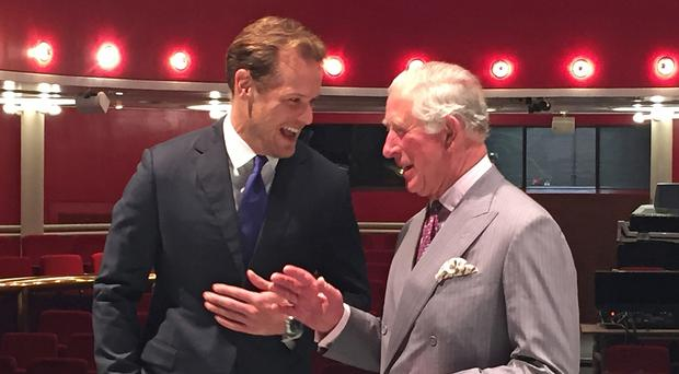 Prince Charles meets Outlander star Sam Heughan during a visit to the Royal Conservatoire of Scotland (RCS) in Glasgow (Lucy Christie/PA)