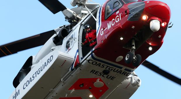 A Coastguard helicopter has been involved in the search (Andrew Milligan/PA)