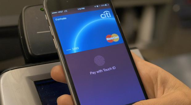 An Apple Pay user pays for an item (Apple)