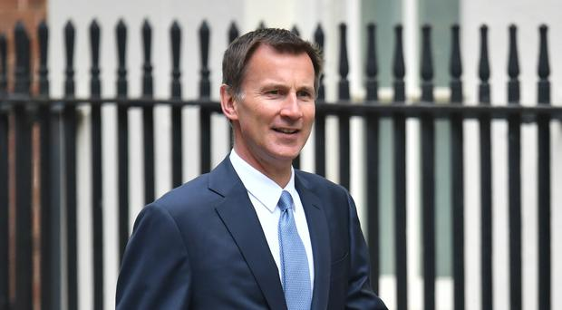 Foreign Secretary Jeremy Hunt said there was a 'glimmer of hope' that cross-party talks could reach a resolution (Dominic Lipinski/PA)