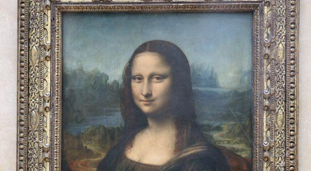 The Mona Lisa may have been left incomplete due to da Vinci's hand injury (Chris Radburn/PA)