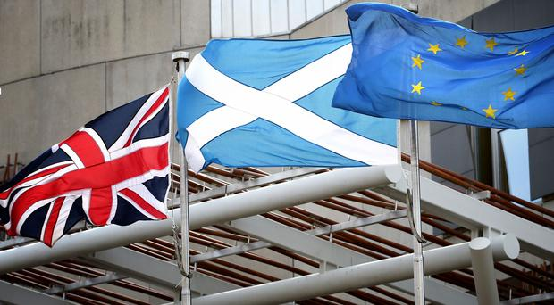 A think tank has called for migration powers to be devolved to Scotland (Jane Barlow/PA)