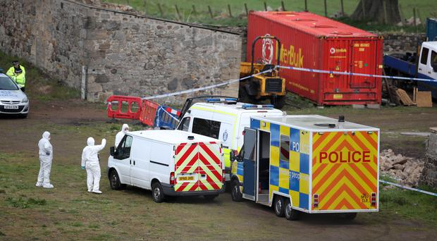 Police and forensic officers attending the scene at the farm (Jane Barlow/PA)