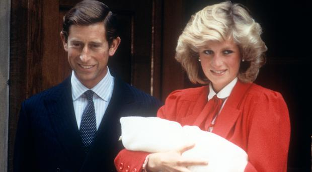 The Prince and Princess of Wales following the birth of their second son Prince Harry in 1984 (PA)