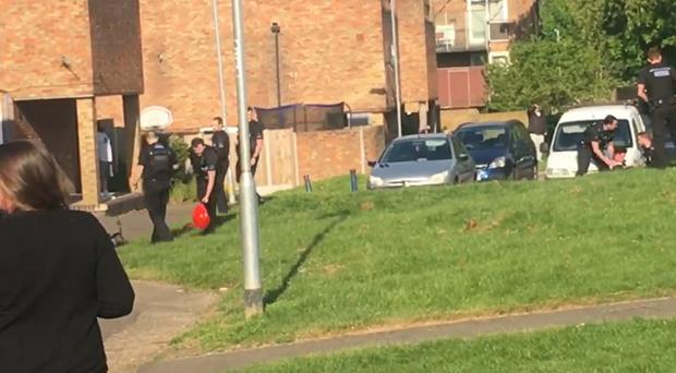 Police officers at the scene in Basildon, Essex (PA)