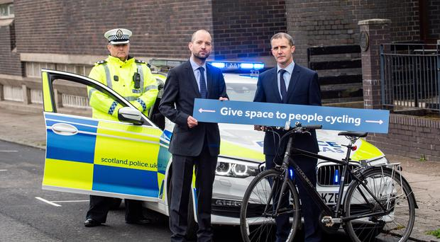 (l to r) Inspector Andrew Thomson, Cycling Scotland chief executive Keith Irving and Michael Matheson at the launch of the campaign (Lenny Warren/Warren Media/PA)