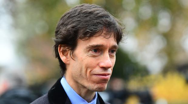 Prisons minister Rory Stewart speak to the media on College Green in Westminster, London.