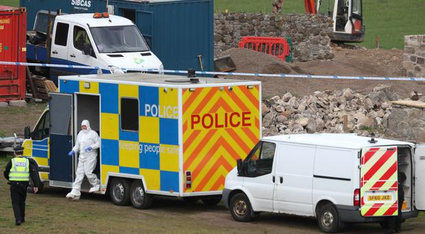 Police and forensic officers attend the farm near Linlithgow, West Lothian (Jane Barlow/PA)