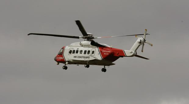 The coastguard helicopter was joined in searches by mountain rescue volunteers and search dogs (Andrew Milligan/PA)