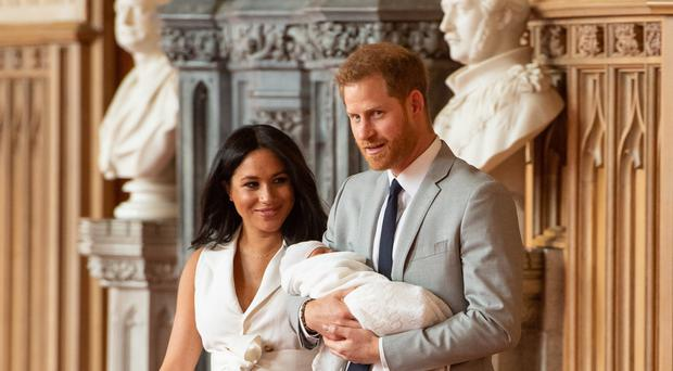 The Duke and Duchess of Sussex with Archie (Dominic Lipinski/PA)