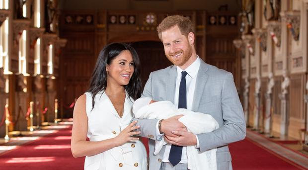 The Duke and Duchess of Sussex with their baby son Archie (Dominic Lipinski/PA)