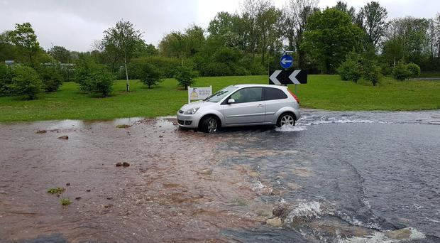 Photo tweeted by Worcestershire's Highways and Travel Information Service showing flooding in Redditch due to a burst water main. (Credit: Worcestershire County Council/PA)