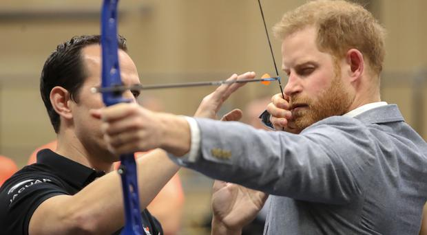 The Duke of Sussex takes aim (Chris Jackson/PA)