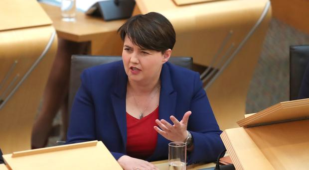 Ruth Davidson pressed the First Minister on policies for school leavers who do not attend university (Jane Barlow/PA)