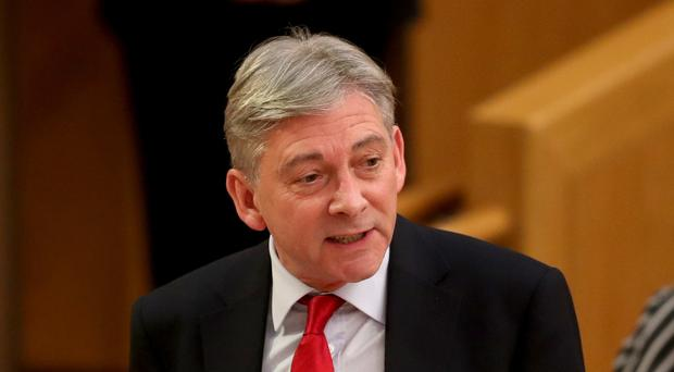 Scottish Labour leader Richard Leonard used First Minister's Questions to call for action to cap private rent rises (PA)