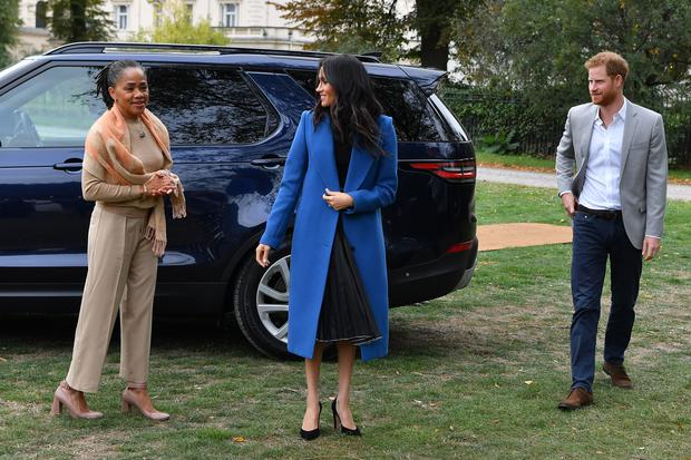 The Duchess of Sussex, accompanied by husband Harry and her mother, Doria Ragland, at Kensington Palace (Ben Stansall/PA)