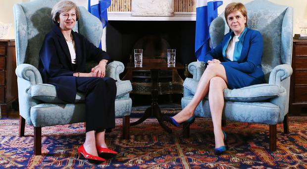 Prime Minister Theresa May (left) and Scotland's First Minister Nicola Sturgeon at Bute House in Edinburgh (Andrew Milligan/PA)