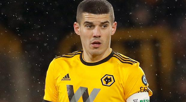 Wolverhampton Wanderers captain Conor Coady wearing a shirt bearing the contested motif (PA)