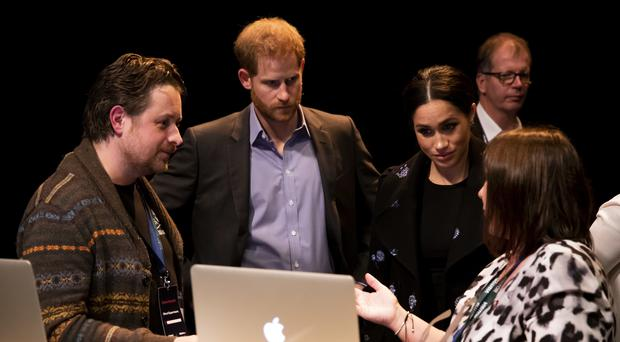 The Duke and Duchess of Sussex meet volunteers working with Shout (PA)