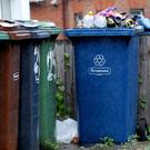 Homeowners want all councils to 'commingle' household recyclables and glass in the same bin (stock photo)