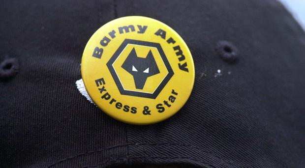 A Wolverhampton Wanderers badge featuring the wolf head logo (Rebecca Naden/PA)