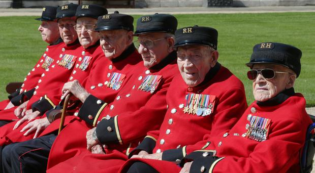 Chelsea Pensioners Roy Cadman, James George, Bill Fitzgerald, Ernie Boyden, Frank Mouque, George Skipper, and Arthur Ellis during a photocall to honour the Royal Hospital Chelsea's remaining Battle of Normandy and D-Day Veterans (Jonathan Brady/PA)