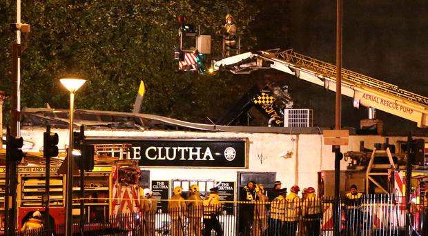 Emergency services at the scene of the crash at the Clutha Vaults pub (Andrew Milligan/PA)