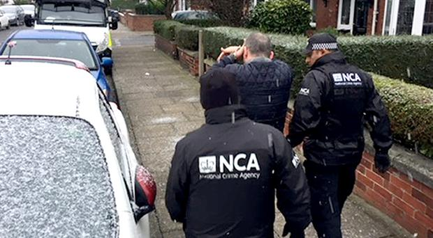 National Crime Agency officers during a raid (NCA/PA)