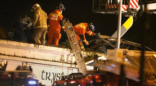 Emergency services at the scene of the crash (Andrew Milligan/PA)