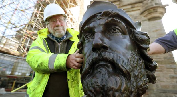 Conservator Restorer Jim Mitchell with part of the bronze statue of William Wallace (Andrew Milligan/PA)