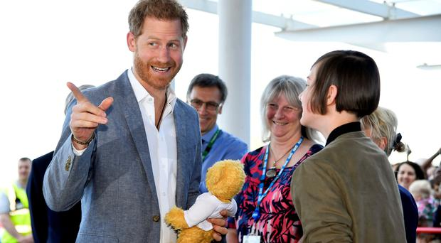 The Duke of Sussex is gifted a teddy bear during a visit to Oxford Children's Hospital (Toby Melville/PA)