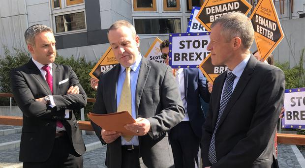 David Macdonald, centre, is now urging voters to back the Liberal Democrats in a bid to keep Britain in the European Union (Katrine Bussey/PA)