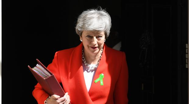 Prime Minister Theresa May leaves 10 Downing Street, London, for the House of Commons for Prime Minister's Questions.