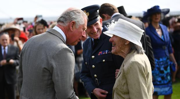 The Prince of Wales speaks to one of the world's oldest marathon runners, Iva Barr, during a garden party at Buckingham Palace (Victoria Jones/PA)