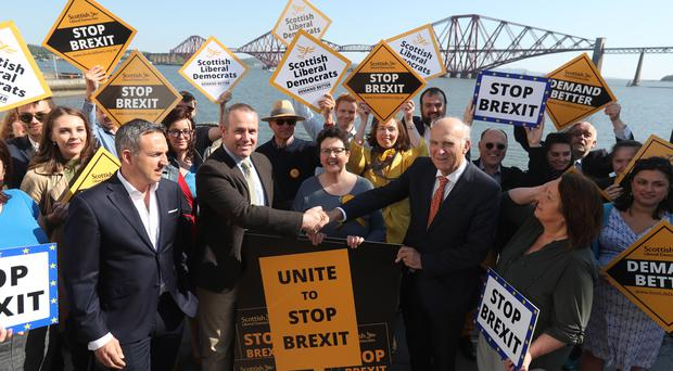 Liberal Democrat leader Vince Cable shakes hands with former Change UK lead candidate David MacDonald as a campaign poster is launched for the European election whilst on the election campaign trail in South Queensferry (Andrew MilliganPA)