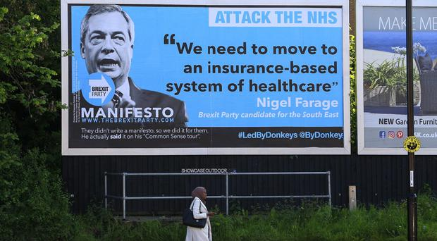 A billboard in Coventry takes aim at Nigel Farage and the Brexit Party (Jiri Rezac/ Led By Donkeys/PA)