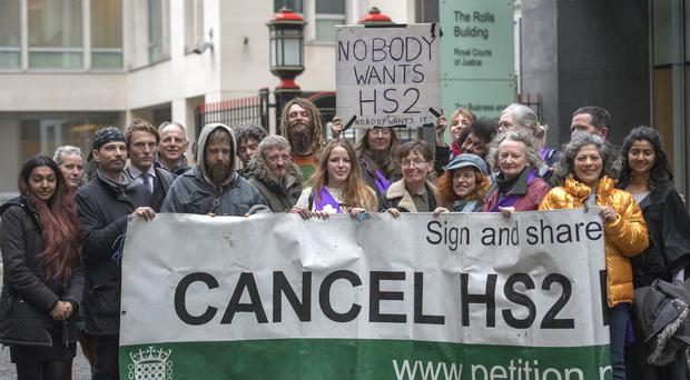 Campaigners attend a hearing over an injunction to stop unlawful protests at an HS2 construction site in a west London woodland area. (Victoria Jones/PA)