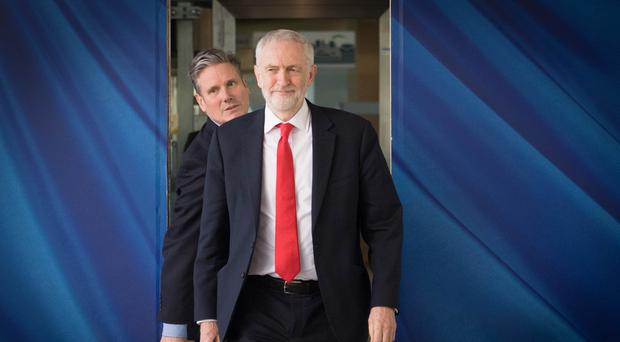 Labour leader Jeremy Corbyn, right, has halted Brexit talks with the Government (PA