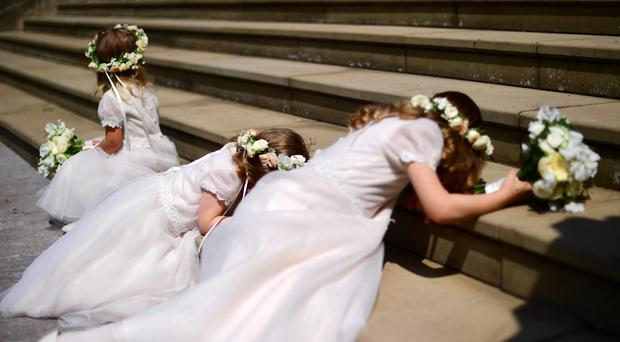 Three of the bridesmaid on the steps of St George's Chapel (Victoria Jones/PA)