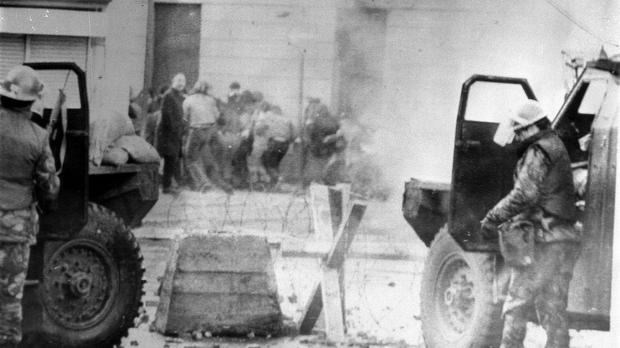 Soldiers take cover during Bloody Sunday in Londonderry in 1972 (PA)