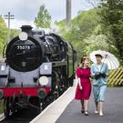 Emma Louise, left, and Abi Carr at Haworth train station during the Haworth 40s weekend (Danny Lawson/PA)