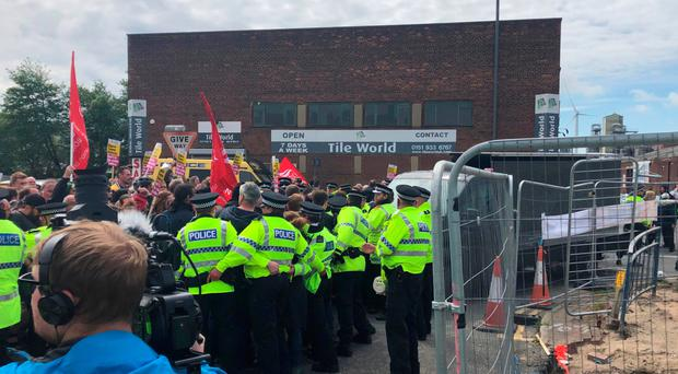 Protesters against Tommy Robinson try to stop a campaign van arriving at Douglas Place in Bootle, Merseyside, during an election campaign event